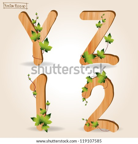 wood alphabet with branch green