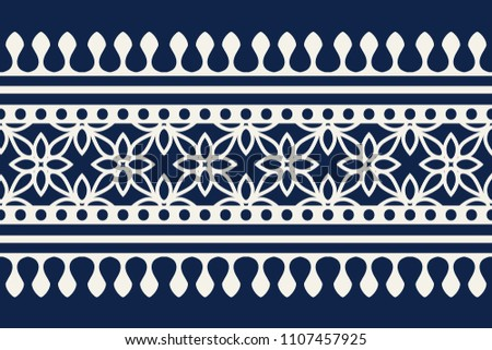Woodblock printed indigo dye seamless ethnic floral border. Traditional oriental ornament of India Kashmir, geometric flowers motif, ecru on navy blue background. Textile design. #1107457925