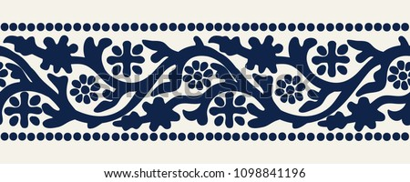 Woodblock printed indigo dye seamless ethnic floral geometric border. Traditional oriental ornament of India Kashmir, flowers wave motif, navy blue on ecru background. Textile design. #1098841196