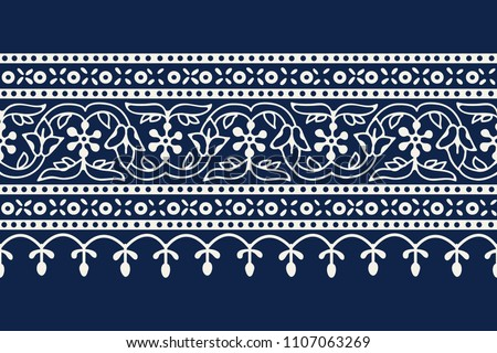 Woodblock printed indigo dye seamless ethnic floral geometric border. Traditional oriental ornament of India Kashmir, flowers wave and arcade motif, ecru on navy blue background. Textile design. #1107063269