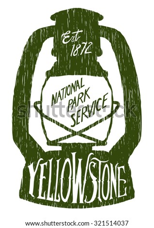Woodcut-style vintage-looking label in the shape of a lantern with hand lettering that says Yellowstone.