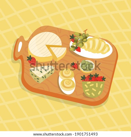 Wooden board with food at picnic. Cheese Brie, Dor Blue with Olives, Croissant for Breakfast.  Strawberry, rolls with cinnamon in summer party. Stockfoto ©