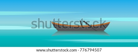 wooden boat with oars against