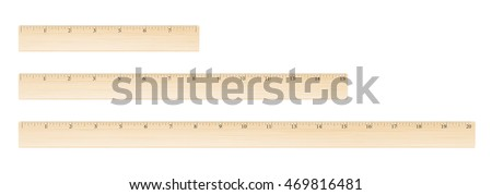 Wooden different size rulers 8, 15 and 20 inch long isolated on white background