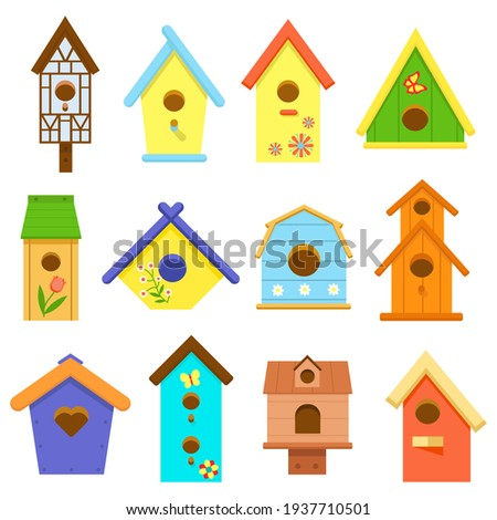 Wooden multi-colored birdhouses isolated on white background. Birdhouse, bird feeder of various shapes. Set of icons. Crafts made of wood and nails. Bird Day, Nature protection. Vector illustration ストックフォト ©