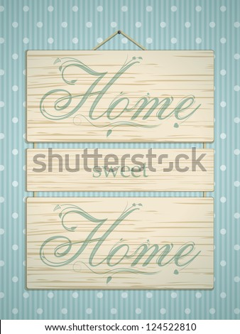 Wooden panel sign with 'home sweet home' message on blue polka dot