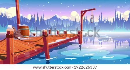 wooden pier on winter lake