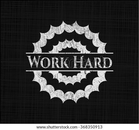Work Hard chalk emblem written on a blackboard