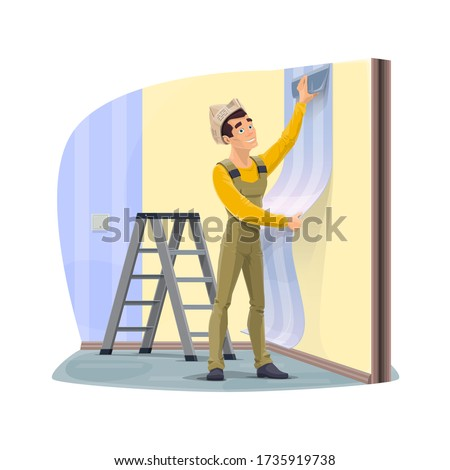 Worker gluing a wallpaper, home renovation. Wallpaper stickman wallpaper on wall with scraper in apartment. Remodeling and repair apartment, construction industry Stockfoto ©