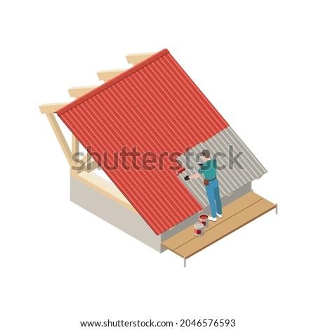 worker painting metal roof in