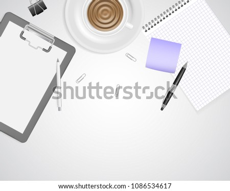 Working place mock up with space for text. White table with office accessories: paper clips, sticker, notepad, pens, clipboard and hot beverage. Top view on creative job process concept.