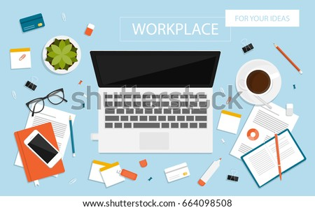 Workplace for business, management and IT. View from above. Laptop, mobile phone, notebook and office supplies on the desktop