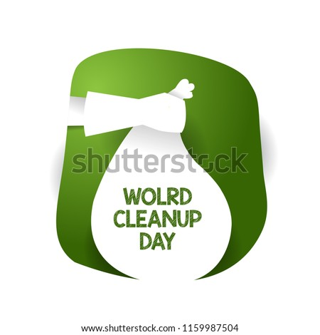 world cleanup day. hand vector that carries garbage. paper art. green. creative design.