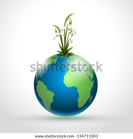 World globe with first spring flowers snodrops - vector illustration