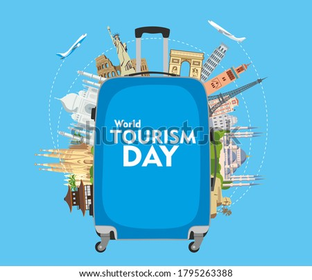 World Tourism Day. The inscription on the blue travel suitcase. Around the monuments of architecture