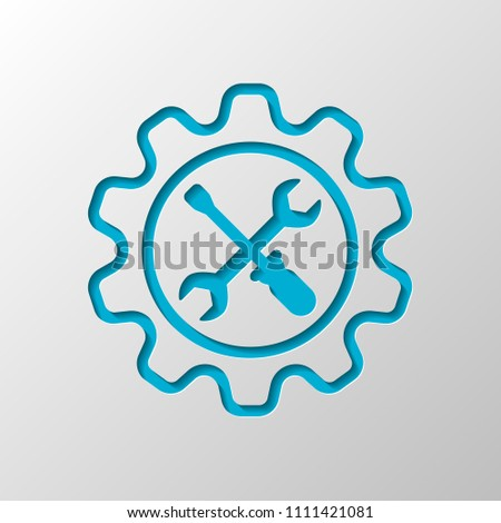 Wrench and screwdriver in gear. Paper design. Cutted symbol with shadow