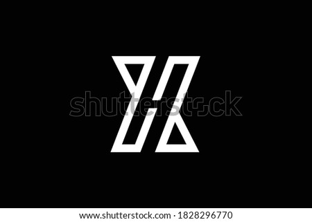 XH letter logo design on luxury background. HX monogram initials letter logo concept. XH icon design. HX elegant and Professional letter icon design on black background. H X XH HX Stock photo ©