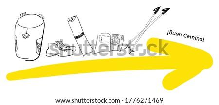 Yellow arrow and pilgrim needed things. Backpack, pilgrim passport, travel mat, trekking sticks, boots, water. type: Buen Camino -  wish a good, Camino de Santiago - Way of St. James - a popular walking trail way Foto d'archivio ©
