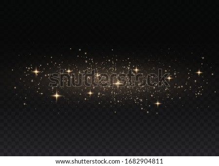 Yellow dust. Beautiful light flashes. Dust particles fly in space. Bokeh effect. Horizontal light rays. Glowing streaks of dust on a dark background