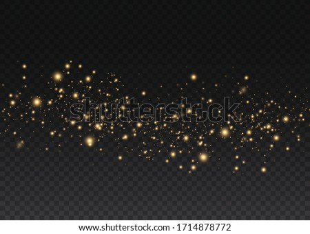 Yellow dust. Bokeh effect. Beautiful light flashes. Dust particles fly in space. horizontal light rays. Glowing streaks of dust on a dark background.