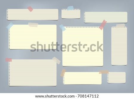 Yellow striped, ruled note, copybook, notebook paper stuck with sticky tape on blue background.