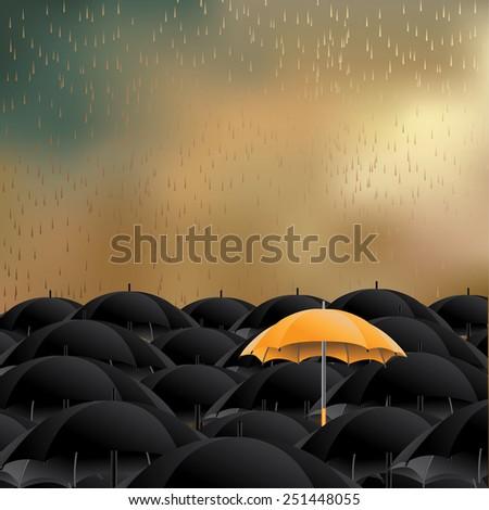yellow umbrella in sea of black