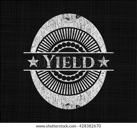 Yield chalkboard emblem on black board