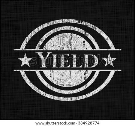 Yield written on a chalkboard