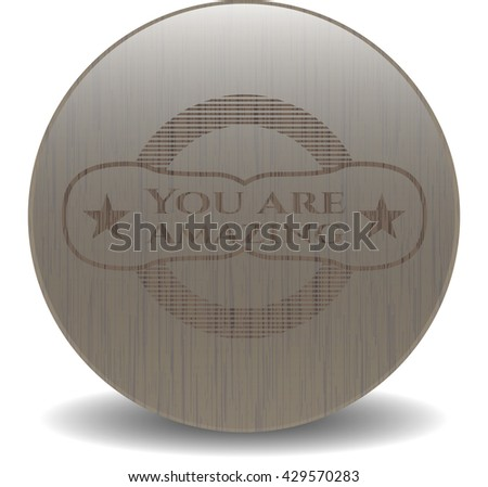 You are Amazing badge with wooden background