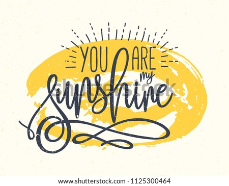 You Are My Sunshine confession or phrase written with beautiful cursive font against yellow round paint stain on background. Artistic vector illustration for St. Valentine's Day greeting card.