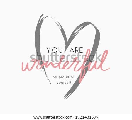 you are wonderful slogan on heart shape brush stroke background for fashion print