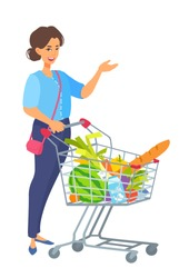 Young adult woman with a shopping cart full of food. Girl smiling, showing something with her hand, holding a trolley handle. Grocery buying. Vector cartoon illustration isolated on white background.