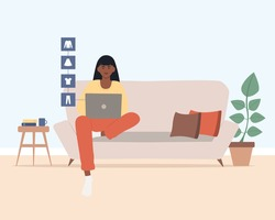Young african american woman with laptop sitting on the couch doing online shopping, buying clothes. Online shopping concept. E-commerce.  Cute vector illustration  cartoon flat style