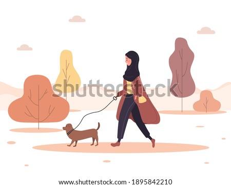 young arab woman in hijab walks