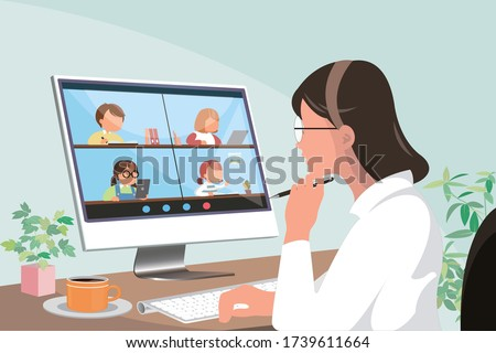 young asian female elementary teacher using tele education technology and device to teach students