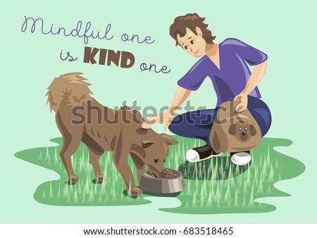 young boy feeding stray dog