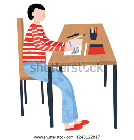 Young boy sitting at table, reading and writing at home. Homeschooling concept. Education, self-learning, self-study