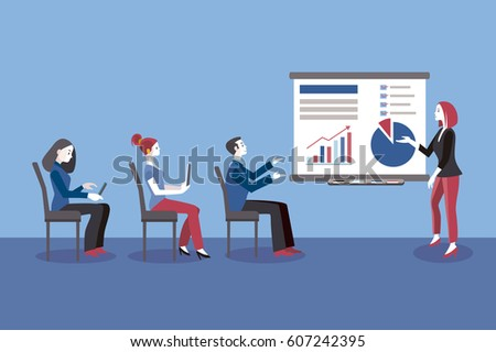 Young business woman giving a class or lecture. Un the audience, seated, there are men and business women. Business Conference concept.