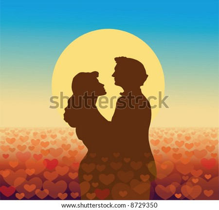 Young couple in silhouette against sunset with heart