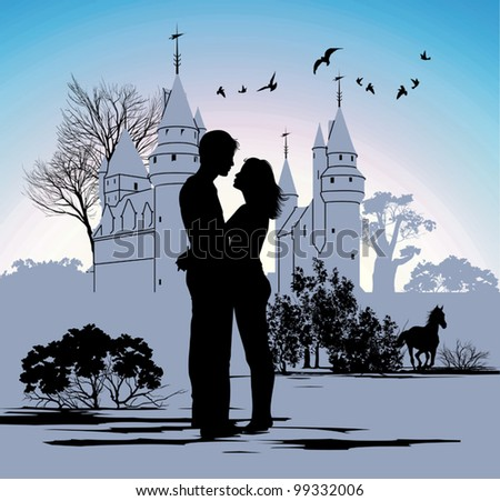 young couple looking at each other against the backdrop of the castle