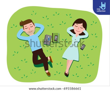 young couple lying on green