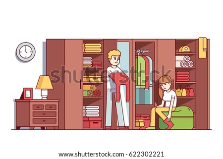 Young couple man and woman dressing up in home wardrobe room. Big closet or dresser full of clothes, boxes, household things. Interior design concept. Flat style vector isolated illustration.