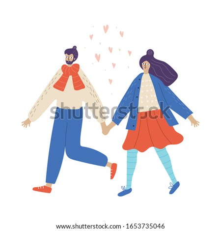 young couple walks in winter