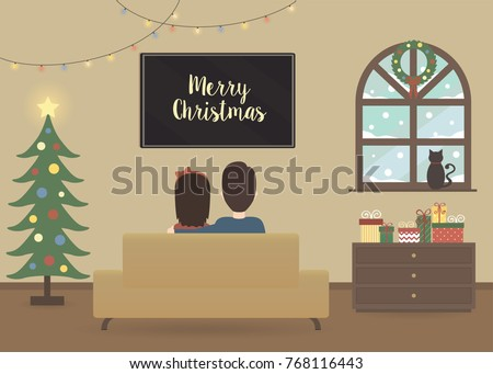young couple watching tv in a