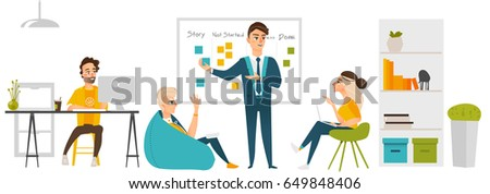 Young development team near the blackboard.Programmers and manager. Manager interacting with a