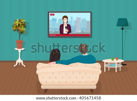 Young family man and women watching TV daily news program together in the living room.