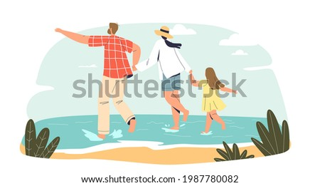 young family on beach happy