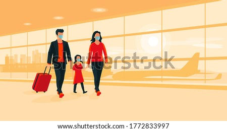 Young family traveler wearing face masks with luggage walking at airport gate terminal lounge traveling during pandemic outbreak. Airplanes behind the glass window. New normal holiday vacation.