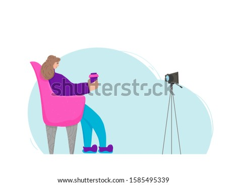 young female blogger sitting in