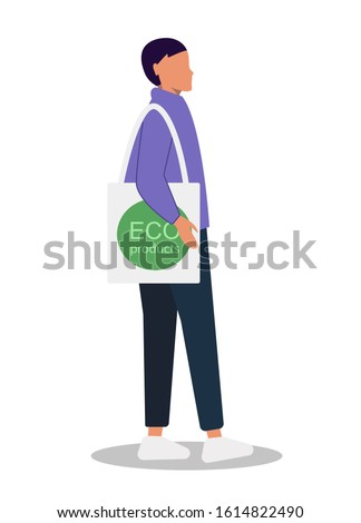 Young girl, young guy, with a bag of eco products. Eco-friendly food. Gender neutrality, unisex, gender neutral clothing, hairstyle. Young girl, young guy, pants and sneakers isolated on white backgro